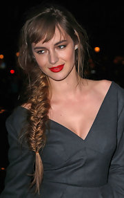 Louise Bourgoin attended the Louis Vuitton fall 2012 fashion show wearing her hair in a long side-swept fishbone braid.