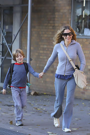 Sarah Jessica Parker chose modern shield sunglasses to protect her eyes while walking her son to school.