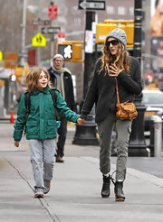 Sarah Jessica Parker took her son to school in fitted olive cargo pants.