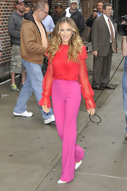 SJP perfected the color-blocking trend in a red blouse with sheer sleeves paired with hot pink pants.