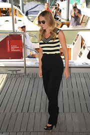 Scarlett Johansson looked ever-so polished in a cream-and-black striped V-neck knit tank.