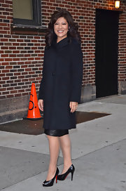 Julie Chen opted for a sophisticated look outside the 'Late Show With David Letterman' in a black single button coat.