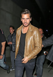 Scott Disick looked cool and edgy in a snakeskin leather jacket.