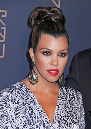 Kourtney Kardashian attended the opening of RYU restaurant in NYC wearing her highlighted tresses in a high loose bun.