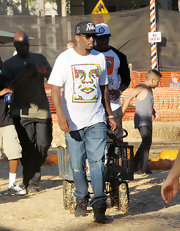 Sean Combs was dressed for comfort in ripped jeans and a print tee during a visit to a pumpkin patch.