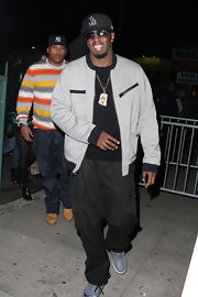 Sean Combs rocked a pair of baggy black cargo pants at the Black Eyed Peas concert.