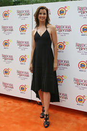 Bridget paired her strappy sandals with a black maxi dress.