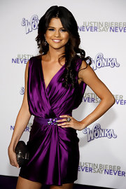 Selena Gomez paired he vibrant purple dress with a sparkling pyramid cocktail ring.