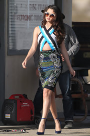 Selena Gomez paired her funky cutout dress with satin wedge pumps while at a video shoot in California.