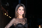Selena Gomez poses for photographs outside of the Ed Sullivan Theater after taping an appearance on