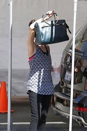 Selena chose a classic leather handbag for her look while out at a dance practice.