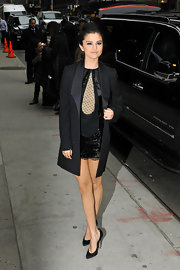 Selena Gomez looked mature and chic in a long black blazer paired over a cute sequined dress.