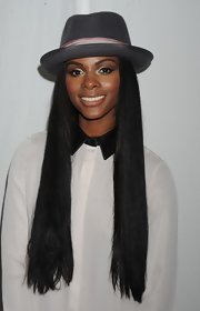Tika Sumpter complemented her simple white button-down with a porkpie hat during Mercedes-Benz Fashion Week.