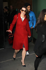 Kristin Davis accessorized her red coat with stilettos slingbacks.