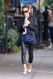 SJP was out and about New York City in chic cropped leather pants. She paired the casual look with a dark blue suede cross-body bag, complete with patent leather accents.