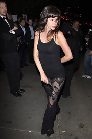 Paz de la Huerta looked totally hot in a black camisole and sheer lace pants while partying at Chateau Marmont.