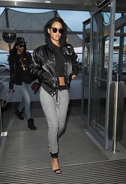 Rihanna dressed up her casual cool separates with strappy stilettos.
