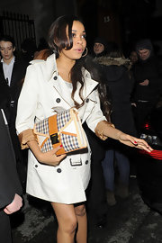 Dionne Bromfield showed off her classy gingham patterned envelope clutch during London's Fashion Week.
