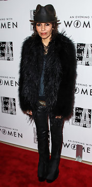 Linda Perry topped off her ensemble with a thick black feather coat at the Evening with Women gala.