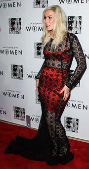 Natasha Bedingfield looked va-va-voom at the Evening with Women gala in a see-through black lace evening dress layered over a red bra and mini skirt.