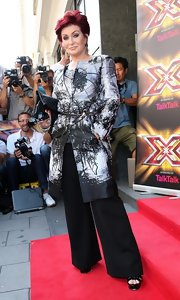 Sharon Osbourne jumped on the picture-print trend by choosing a belted tree-print coat.