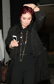 Sharon Osbourne wore a layered chain and charm necklace while dining out with a friend at Madeo Restaurant.