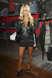 Shauna Sand looked like an edgy Barbie in her black platform sandals and leather jacket during a Fashion's Night Out event.