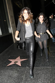 Shenae paired her leather leggings with a patent leather Morning After clutch.