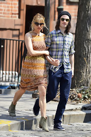 Sienna Miller chose a sleeveless print dress for her daytime look while out in NYC.