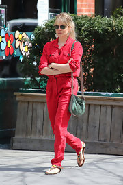Sienna Miller rocked a cherry red jumpsuit while out in NYC.