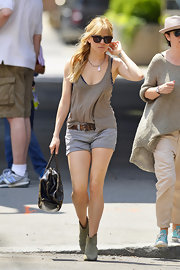 Sienna Miller looked casual and cool in a flowing tan tank.