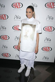 Ciara sported this Madonna tee with an uneven hem for her pre-show look at the Haze Nightclub.