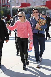 A fuzzy, bright pink crewneck sweater showed both  Ellie Goulding's style and personality.
