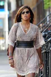 Eve sported a girly summer look with this nude lace dress while strolling in New York City.