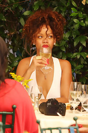 Rihanna sports a perfect manicure complete with vibrantly colored nails while spending time in Italy.