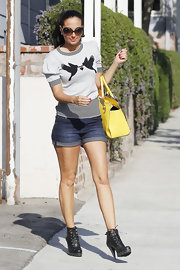 Tulisa paired her denim shorts with black lace-up ankle boots.