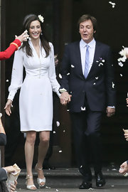 Nancy Shevell opted for a simple Stella McCartney-designed long-sleeve white dress for her wedding to Paul McCartney.