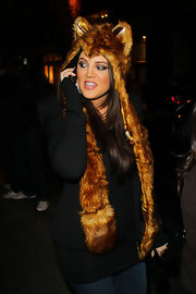 Khloe dons a quirky fur hat with long flaps and cute bear ears.
