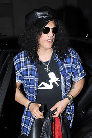 Slash added some color to his ensemble with a blue plaid button-down while out and about in London.
