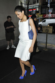 Freida Pinto accented her sophisticated white sheath outside the 'Today Show' with a blue quilted flap bag with a silver chain strap.