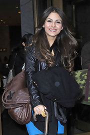 Victoria Justice was all smiles as she left a New York studio. She carried a brown leather tote bag, which didn't really match anything else she was wearing but we still love her.