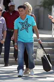 Paul left the E! studios wearing classic jeans and a bright T-shirt.