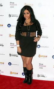 Nicole Polizzi puckered up on the red carpet while wearing a pair of slouchy black leather boots.
