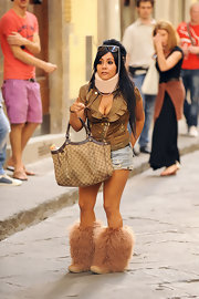 Nicole 'Snookie' Polizzi made a statement in the streets of Florence in furry tan boots.