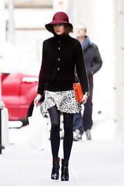 Olivia Palermo chose a knit cardigan to pair with her print skirt for a chic and comfy look while out in NYC.