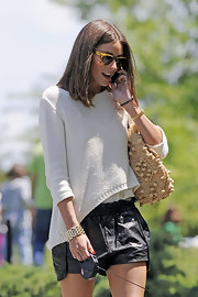 Olivia Palermo was seen walking her dog in NYC wearing this loosely knit sweater.