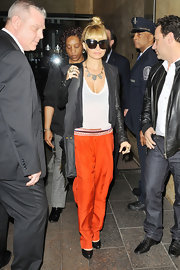 Nicole Richie added pop to her outfit with bright orange slacks.