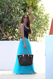 Sofia's bright turquoise skirt was the perfect choice for vacay in Miami.