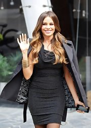 Sofia chicly tossed a black trench over her shoulders to expose her glittering LBD while out in NYC.