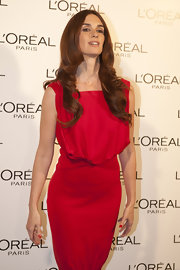 Paz Vega wore her long hair with a sleek center part and layered curls during fashion week in Madrid.